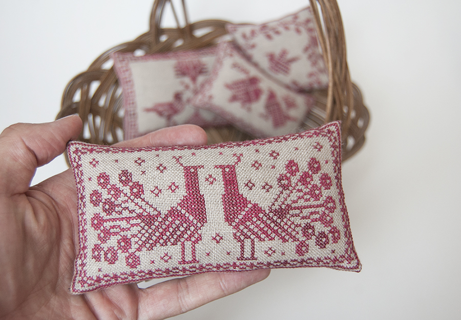 Cross-stitch pincushion design by Modern Folk Embroidery